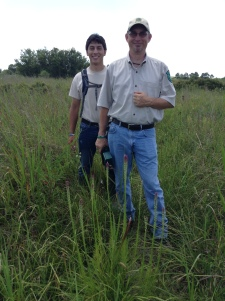 Pablo (l) and Kelly at Deer Park Prairie in front of a Liatris acidota, just starting to bloom.